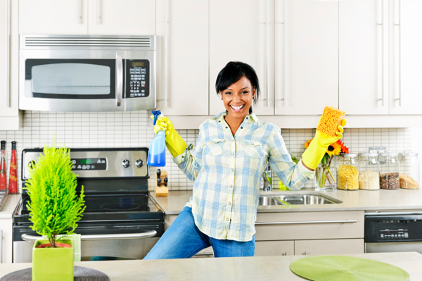 woman-cleaning-and-dancing-in-kitchen